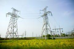 towers den blåa elektriska skyen för bakgrund två Arkivbild