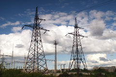 Towers of distribution power lines. High voltage electrical powe Royalty Free Stock Photo