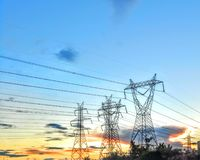 Towers of electricity. Sunset of electricity Royalty Free Stock Images