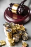 Towers with euro coins and justice hammer in the background stock image