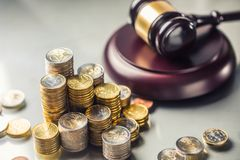 Towers with euro coins and justice hammer in the background. Currency court gavel european money judge wooden law legal banknote business mallet bribery concept stock image