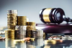 Towers with euro coins and justice hammer in the background. Currency court gavel european money judge wooden law legal banknote business mallet bribery concept royalty free stock photography