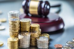 Towers with euro coins and justice hammer in the background. Currency court gavel european money judge wooden law legal banknote business mallet bribery concept stock photography
