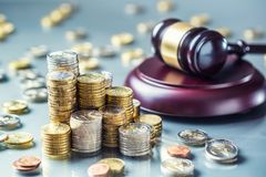 Towers with euro coins and justice hammer in the background. Currency court gavel european money judge wooden law legal banknote business mallet bribery concept royalty free stock photos