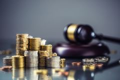 Towers with euro coins and justice hammer in the background royalty free stock image