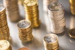 Towers of the euro coins stacked in different positions. Money currency business background financial finance bank european cash banking investment economy pile stock photography