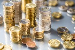 Towers of the euro coins stacked in different positions. Money currency business background financial finance bank european cash banking investment economy pile stock photo