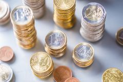 Towers of the euro coins stacked in different positions. Money currency business background financial finance bank european cash banking investment economy pile stock image
