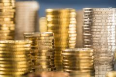 Towers of the euro coins stacked in different positions stock photography