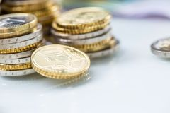 Towers with euro coins stacked together - close-up royalty free stock photo