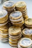 Towers with euro coins stacked together - close-up stock images