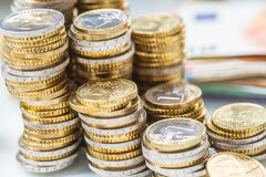 Towers with euro coins stacked together - close-up stock photography
