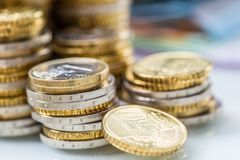 Towers with euro coins stacked together - close-up royalty free stock photography