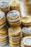Towers with euro coins stacked together - close-up royalty free stock photos