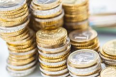 Towers with euro coins stacked together - close-up stock photo