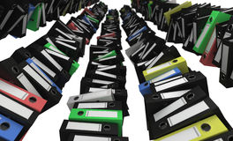 Towers of folders. Piles of colored folders like high towers Stock Images