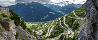 Towers of Fraele ascent wide view, Touristic attraction in Valtellina. Ultra wide panorama of U-shape curved road towards Towers of Fraele, a Touristic Stock Image