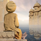Towers on the Ganges. Old indian man near towers on the Ganges Royalty Free Stock Photos