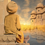 Towers on Ganges river. Holy man near towers on the Ganges river in the sunset Royalty Free Stock Photography