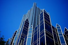 Towers of Glass and Steel Point Skyward. Glass and steel walls of a skyscraper point toward the sky Stock Images