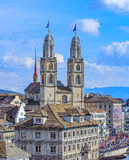 Towers of the Grossmunster decorated with flags of Zurich Stock Photo