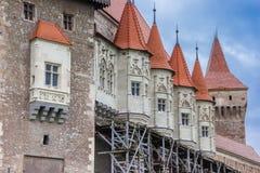 Towers of the Hunedoara Castle. In Romania Stock Photography