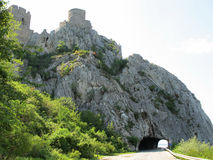 Towers of medieval fort on high rock and traffic tunnel Royalty Free Stock Images