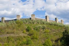 Towers of medieval fortress of Monteridzhioni in the September afternoon. Tuscany, Italy Stock Photography