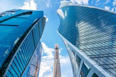 Towers of Moscow skyscrapers with a view from below. Russia, Mos royalty free stock images