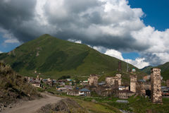 Towers in mountain village Stock Images