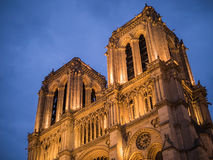 Towers of Notre Dame, lighted at night, Paris, France Stock Photo