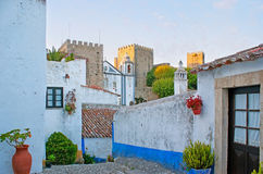 The towers of Obidos. The medieval architecture of Obidos, the picturesque town with preserved fortress walls and towers, historic churches and scenic housing Stock Photo