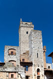 Towers  on Piazza della Cisterna in San Gimignano in tuscany in italy Stock Photos
