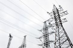 Towers power lines against a cloudy sky background. Electricity. Transmission pylons stock image