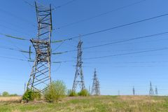 Towers and power lines. In the open field on a summer day stock images