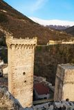Towers and rampart of Pacentro castle at sunset Italy Royalty Free Stock Image
