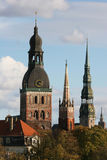 Towers of Riga. Towers of Old Town (Riga, Latvia) in autumn. View from Daugava river Stock Photography