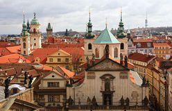 Towers, roofs and spirits. View over Stare Mesto district at Prague Stock Photos