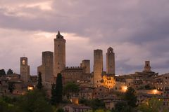 Towers of San Gimignano in the cloudy evening twilight. Tuscany, Italy Royalty Free Stock Photography