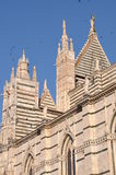 Towers of Santa Maria Assunta Cathedral in Siena, Italy Royalty Free Stock Images