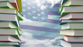 American flag and school books. Towers of school books against american flag blowing in the wind background stock video footage