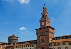 Towers of Sforza Castle (XV c.). Milan, Italy. Tower of Filarete and corner tower of Sforza Castle (Castello Sforzesco, circa XV c.). View from inner yard. Milan Royalty Free Stock Photo