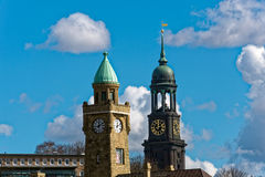 Towers of St. Michaelis Church and Landungsbrücken. Photo of Towers of St. Michaelis Church and Landungsbrücken Stock Image