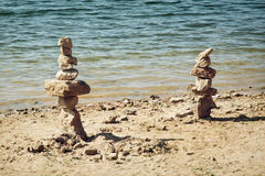 Towers of stone on the lakeside Royalty Free Stock Images