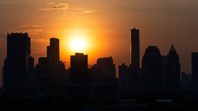 Towers Sunset. Towers at city under sunset Royalty Free Stock Photo