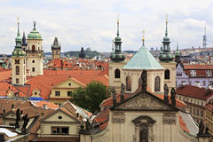 Towers of temples and sculptures on the roofs. In the historic center of Prague Royalty Free Stock Image