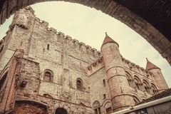 Towers of 12-th century Gravensteen brick castle in Ghent, Belgium. Example of architecture of the Middle Ages in Europe.  stock photo