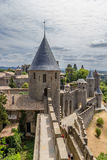 Towers and walls of the fortress of Carcassonne, France. UNESCO List. Chateau Comtal is located within the fortress of Carcassonne, which was founded by the Stock Photography