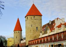 Towers and walls of old Tallinn. The architecture of the old town: the towers and walls cobblestone streets Stock Images