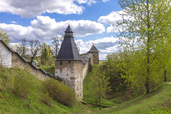 Towers and walls of the Pskovo-Pechersky Dormition Monastery. Fortifications of the Pskovo-Pechersky Dormition Monastery royalty free stock photography